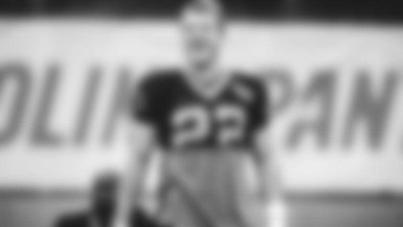 Christian McCaffrey smiling at practice