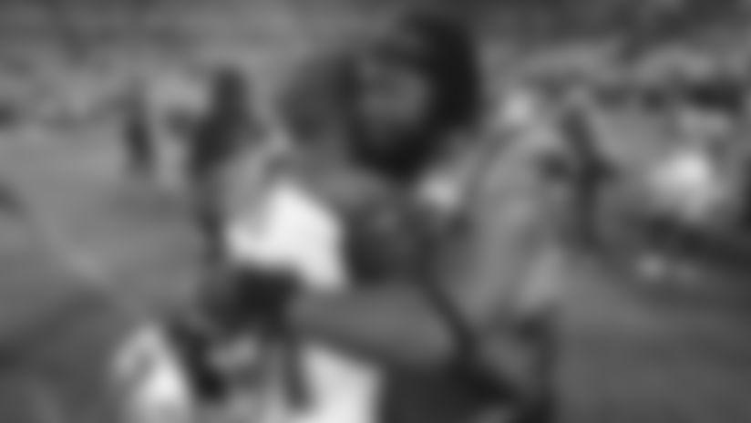 Gerald McCoy hugs Lavonte David