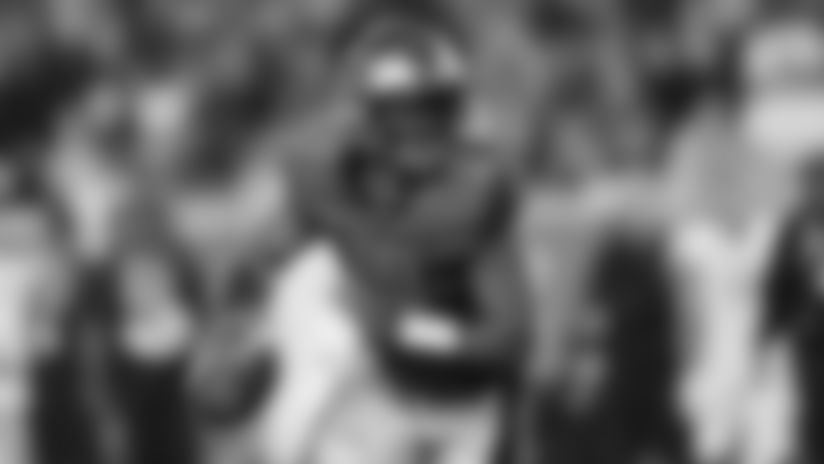 Houston Roughnecks quarterback P.J. Walker (11) looks to pass as he scrambles during an XFL football game, Saturday, Feb. 8, 2020, in Houston. (AP Photo/Matt Patterson)