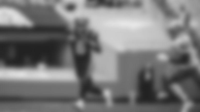 P.J. Walker throws against Lions