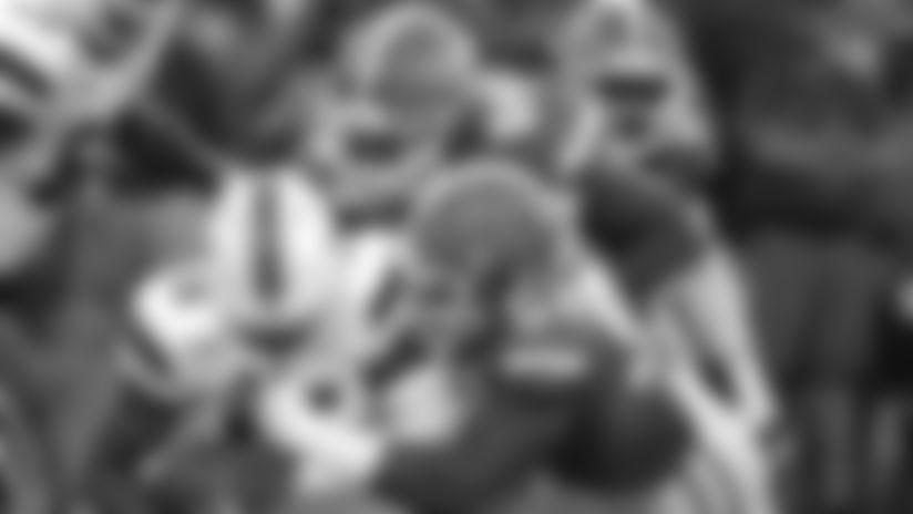 Miami quarterback Jarren Williams, left, is sacked by defensive lineman Adam Shuler, center, and defensive lineman Jabari Zuniga, right, the first half of an NCAA college football game, Saturday, Aug. 24, 2019, in Orlando, Fla. (AP Photo/John Raoux)