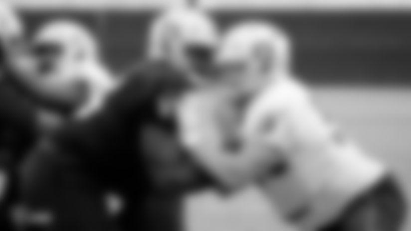 Raiders tackle Brandon Parker (75) blocks defensive end Josh Mauro (97) during practice.