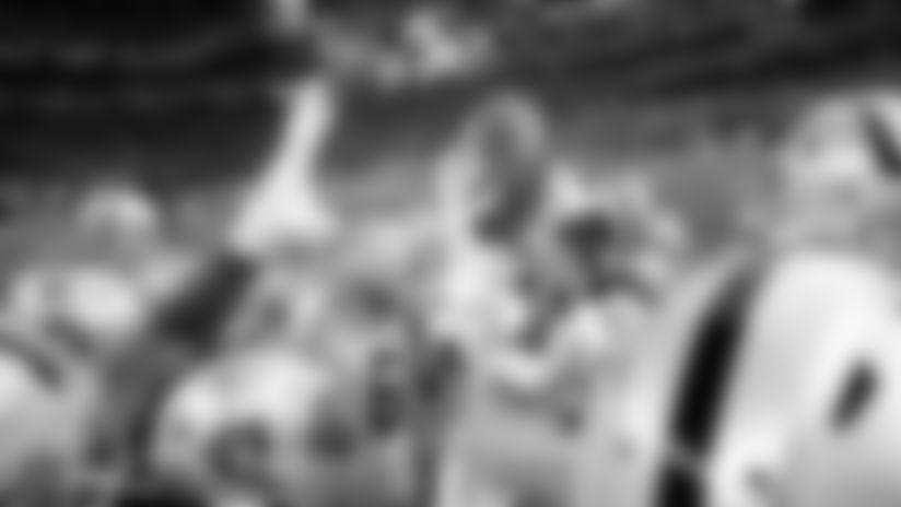 The Oakland Raiders huddle up before their regular season game against the Minnesota Vikings at U.S. Bank Stadium.