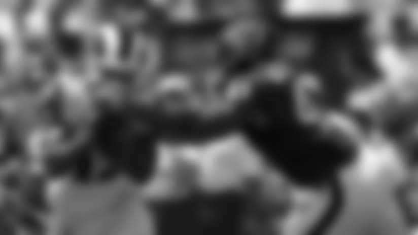 Los Angeles Rams running back John Kelly runs around Houston Texans linebacker Kennan Gilchrist during the first half in an NFL preseason football game Saturday, Aug. 25, 2018, in Los Angeles. (AP Photo/Mark J. Terrill)