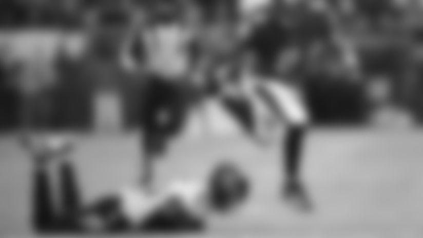 Baltimore Ravens quarterback Lamar Jackson (8) runs past Tennessee Titans cornerback Logan Ryan (26) during the second half an NFL divisional playoff football game, Saturday, Jan. 11, 2020, in Baltimore. (AP Photo/Nick Wass)