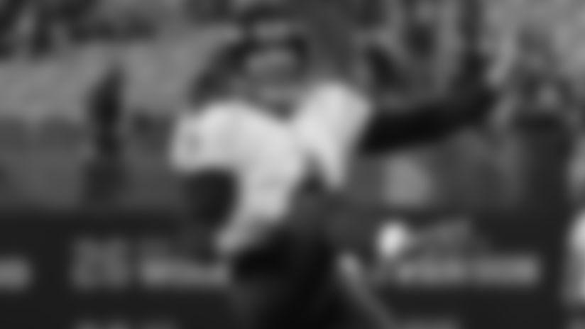 P Sam Koch kicks a punt during an NFL game.
