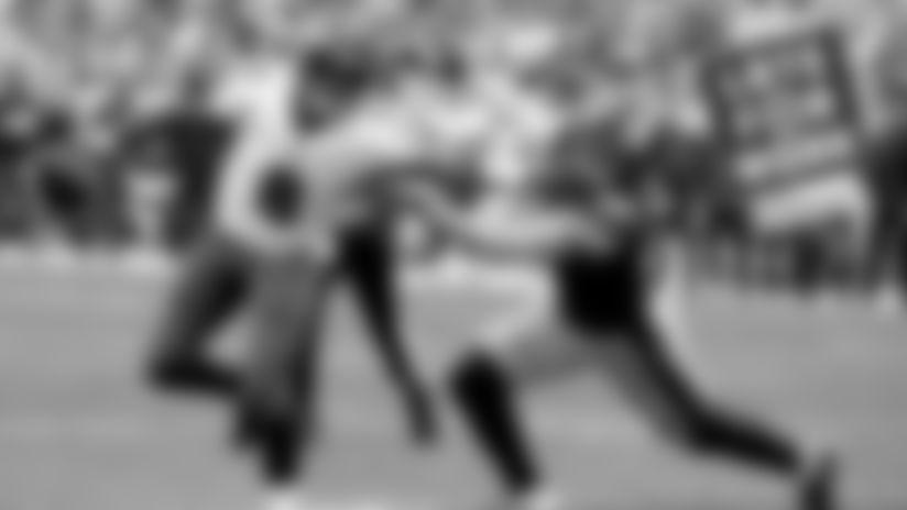 QB Lamar Jackson stiff arms Pittsburgh OLB T.J. Watt