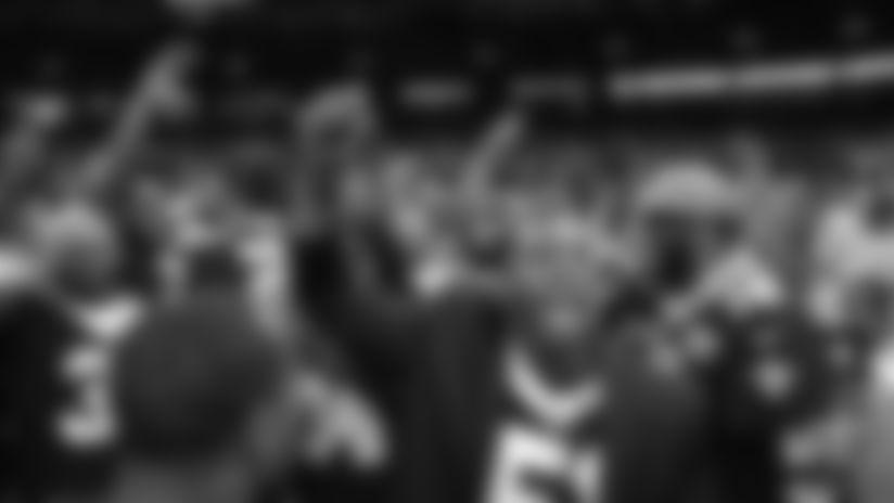 The 2009 Saints Super Bowl team leads the pregame chant vs. Colts