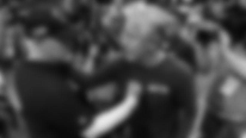 Atlanta Falcons head coach Dan Quinn, left, speaks with Seattle Seahawks head coach Pete Carroll after an NFL football game, Sunday, Oct. 27, 2019, in Atlanta. The Seattle Seahawks won 27-20. AP Photo/John Bazemore)