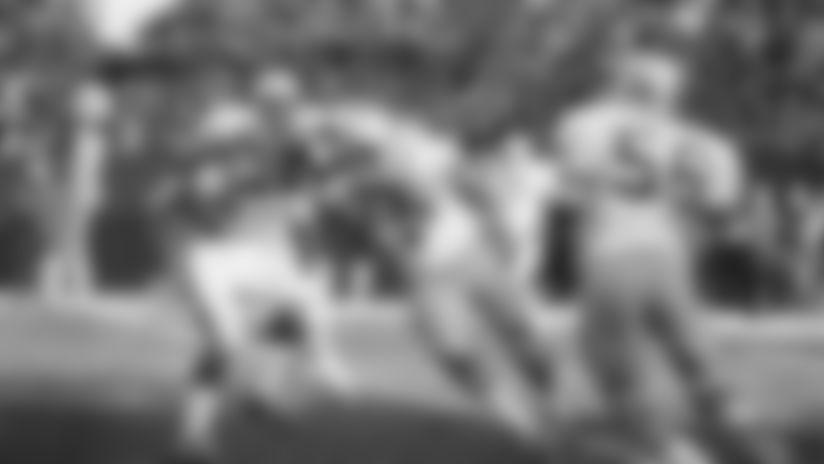 Fran Tarkenton Minnesota Vikings quarterback about to be sacked by Seattle Seahawks tackle Dick Harris (77) on Dec. 14, 1976. (AP Photo)