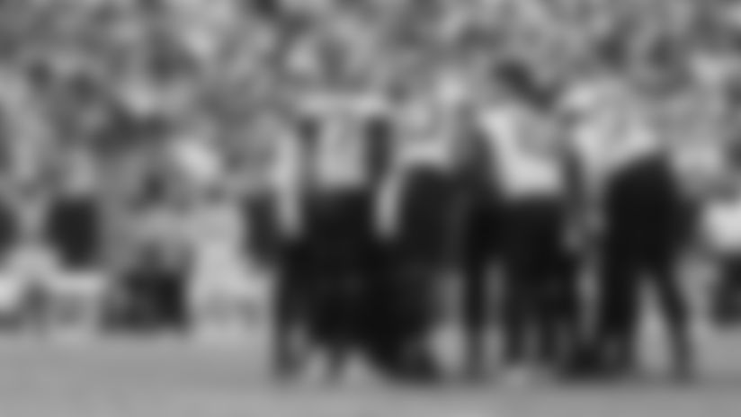 Jacksonville Jaguars quarterback Gardner Minshew (15) calls a play in the huddle during a NFL football game against the Carolina Panthers, Sunday, Sept. 6, 2019 in Charlotte, N.C. (Logan Bowles via AP)
