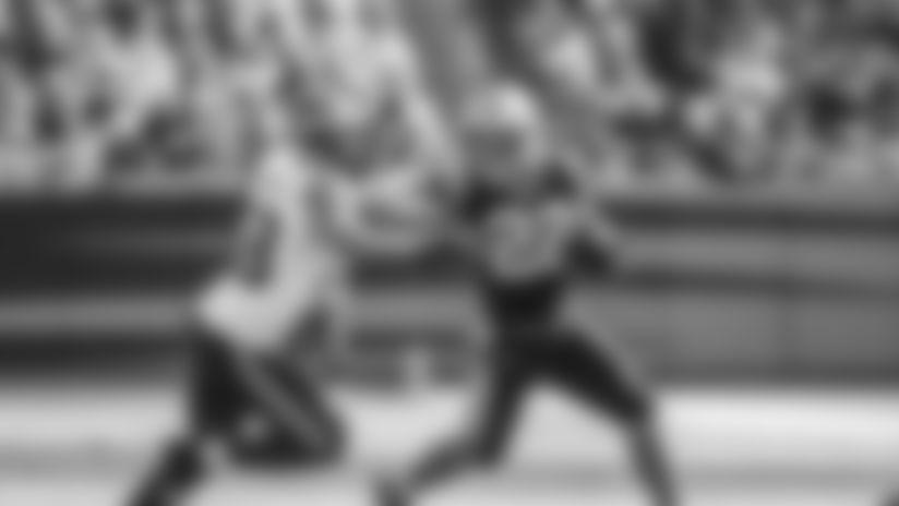 Christian McCaffrey runs against Seattle