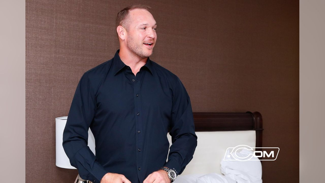 Brian Urlacher in his hotel room, waiting to find out if he would be voted into the Pro Football Hall of Fame's 2018 induction class.
