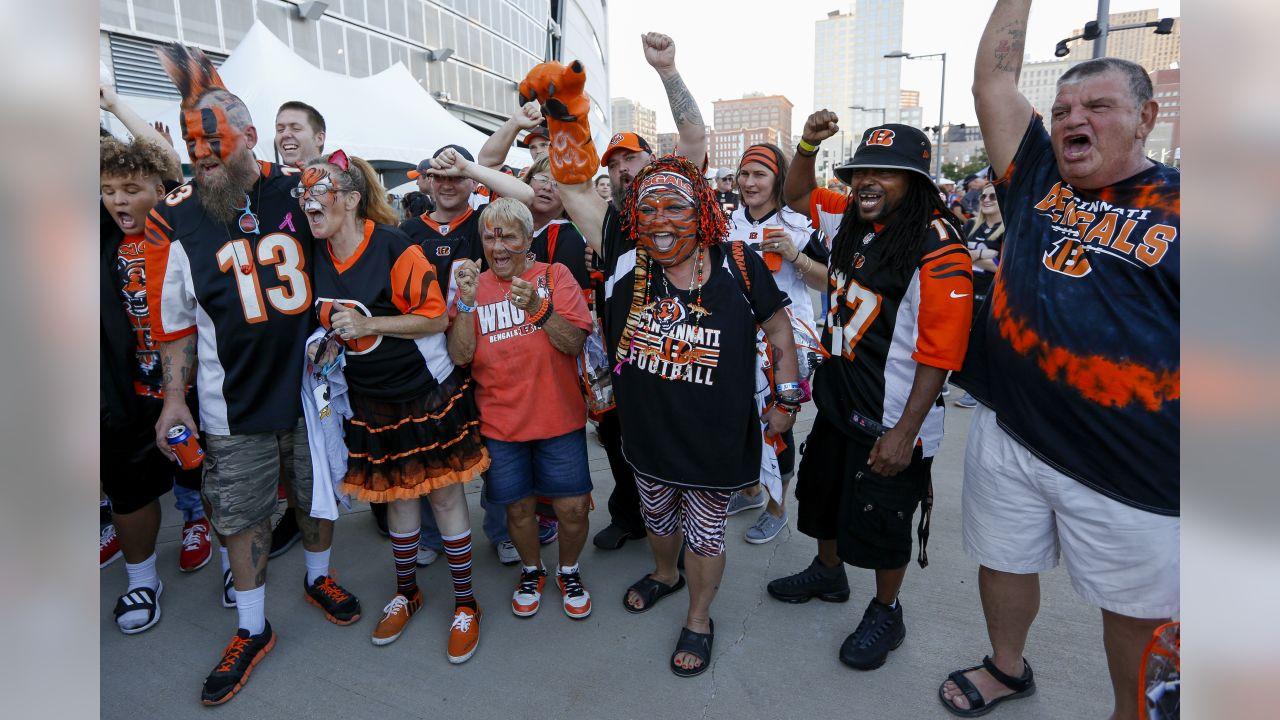 Fan cheers outside Paul Brown Stadium before an NFL football game between the Cincinnati Bengals and the Baltimore Ravens, Thursday, Sept. 13, 2018, in Cincinnati. (AP Photo/Frank Victores)