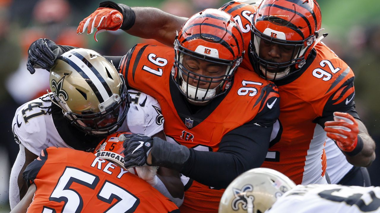 New Orleans Saints running back Alvin Kamara (41) is tackled by Cincinnati Bengals defensive tackle Josh Tupou (91), defensive tackle Adolphus Washington (92) and outside linebacker Vincent Rey (57) in the first half of an NFL football game, Sunday, Nov. 11, 2018, in Cincinnati. (AP Photo/Gary Landers)
