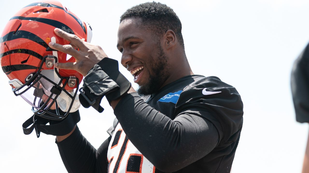 Bengals DE Carlos Dunlap jokes with teammates before the start of the team's first training camp practice.