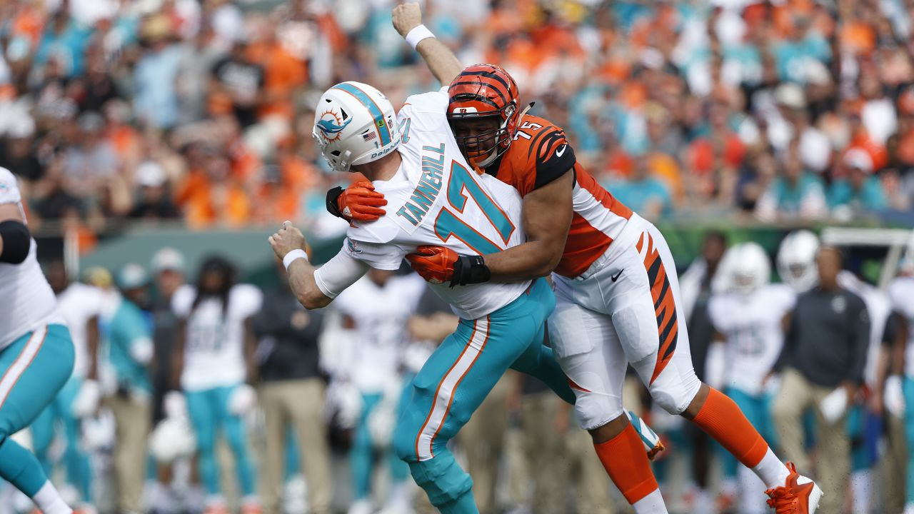 Miami Dolphins quarterback Ryan Tannehill (17) is hit by Cincinnati Bengals defensive end Jordan Willis (75) during the first half of an NFL football game in Cincinnati, Sunday, Oct. 7, 2018. (AP Photo/Frank Victores)