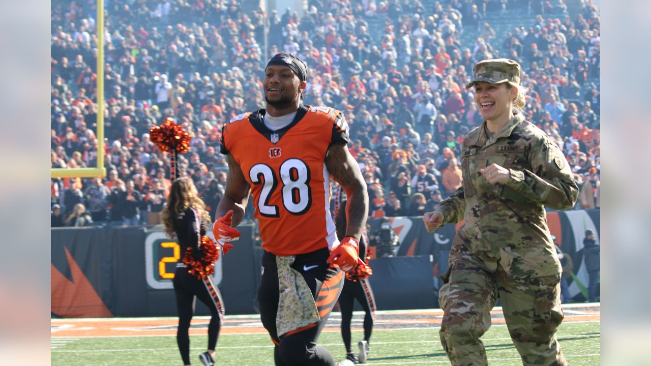 "Joe Mixon runs out on the field during introductions of the ""Salute to Service"" game."