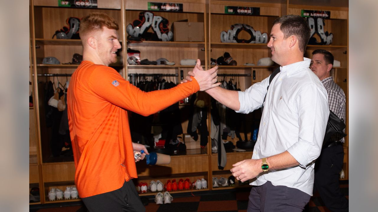 Andy Dalton greets new Bengals head coach Zac Taylor in the locker room.