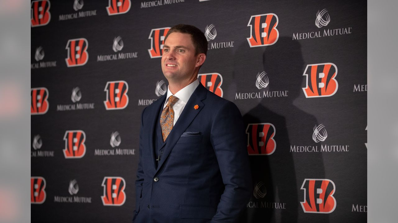Bengals head coach Zac Taylor poses for photos in his introductory press conference.
