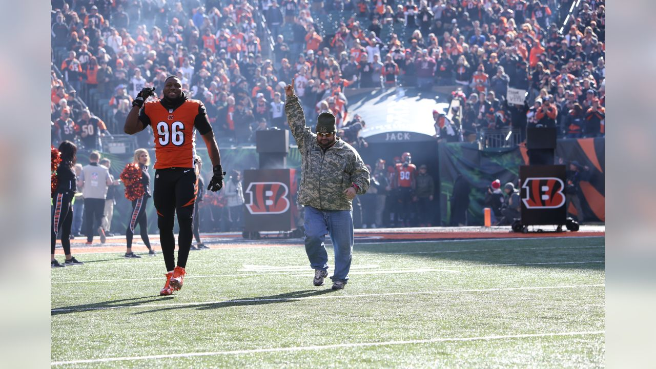 Carlos Dunlap runs out onto the field during the Bengals' Salute to Service game against the New Orleans Saints.