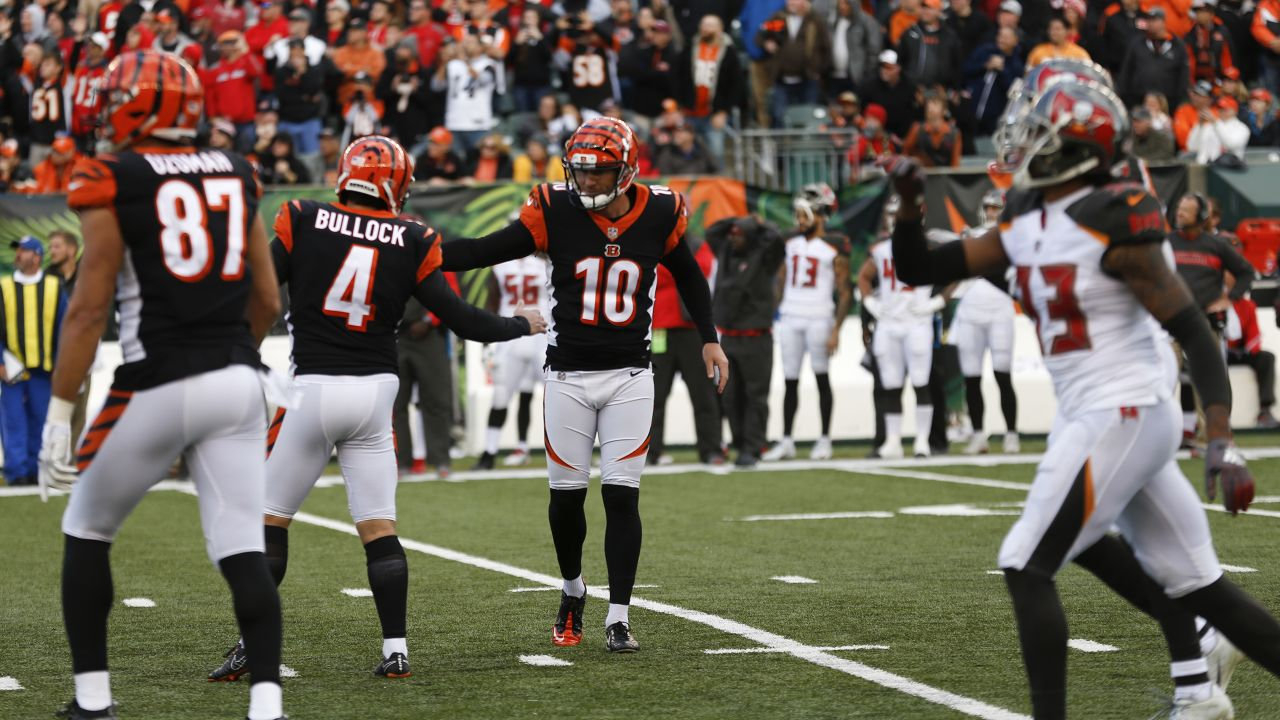 Cincinnati Bengals kicker Randy Bullock (4) celebrates a game-winning field goal from the hold of Kevin Huber during the second half of an NFL football game against the Tampa Bay Buccaneers in Cincinnati, Sunday, Oct. 28, 2018. The Bengals defeated the Buccaneers 37-34. (AP Photo/Frank Victores)
