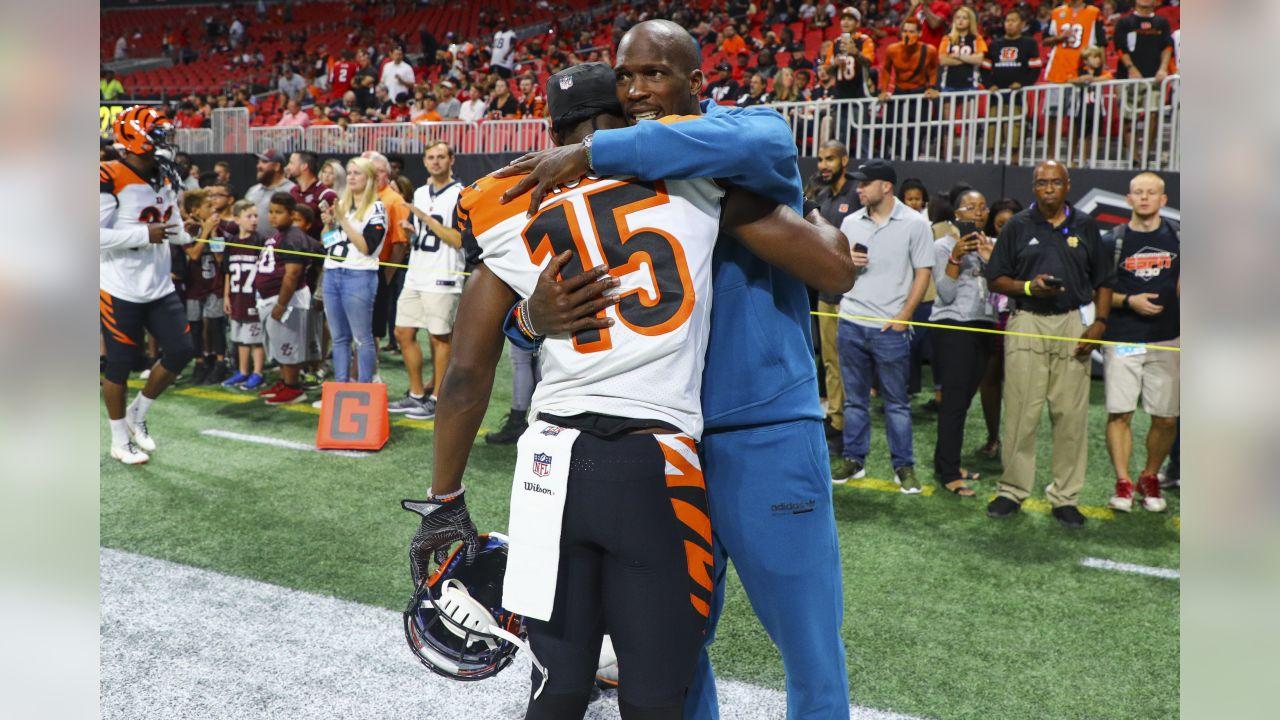 Former Cincinnati Bengals wide receiver Chad Johnson hugs Cincinnati Bengals wide receiver John Ross (15) prior to a game against the Atlanta Falcons, Sunday, Sept. 30, 2018 in Atlanta. Cincinnati won 37-36. (Logan Bowles via AP)