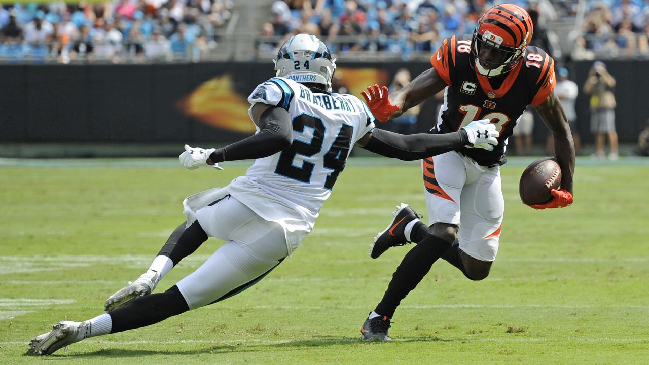 Cincinnati Bengals' A.J. Green (18) runs after a catches Carolina Panthers' James Bradberry (24) defends during the first half of an NFL football game in Charlotte, N.C., Sunday, Sept. 23, 2018. (AP Photo/Mike McCarn)
