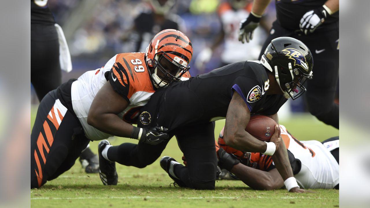Cincinnati Bengals defensive tackle Andrew Billings, left, sacks Baltimore Ravens quarterback Lamar Jackson in the second half of an NFL football game, Sunday, Nov. 18, 2018, in Baltimore. (AP Photo/Gail Burton)