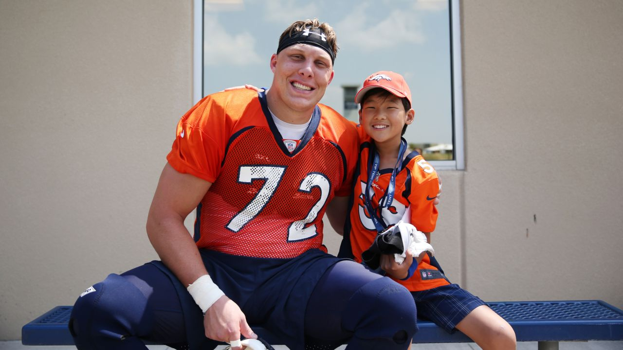 Garett Bolles with Children's Hospital Colorado Junior Reporter Nate during training camp on August 14, 2018.