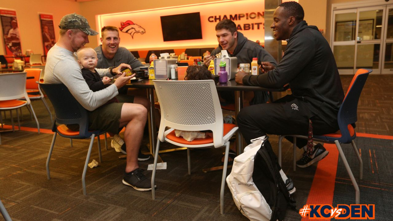 Casey Kreiter, his son Landen, Jeff Heuerman, Brian Parker, and Joe Jones and his daughter Scarlette during a family breakfast at UCHealth Training Center on September 30, 2018.