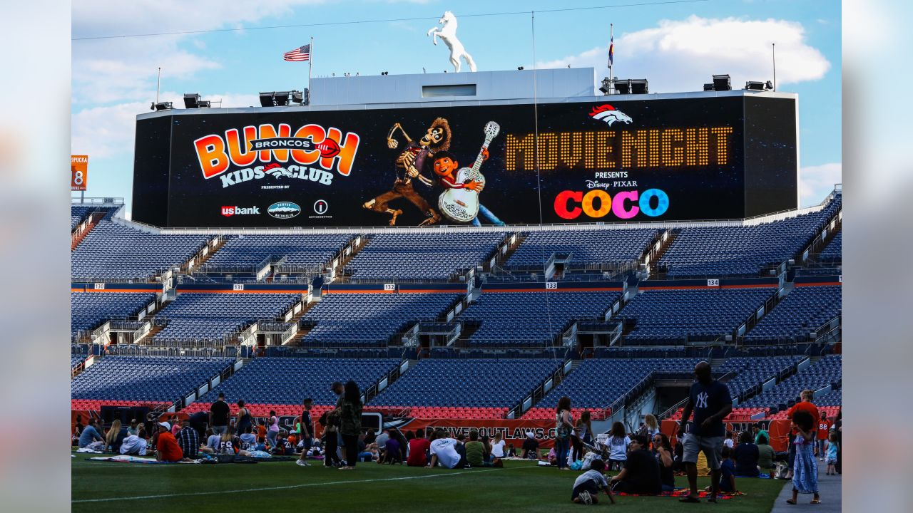 """The Broncos hosted their annual Broncos Movie Night at Broncos Stadium at Mile High on Friday, July 13. This year they screened """"Coco,"""" so the event included Day of the Dead decorations, face painting, coloring activities, a mini pi–ata station and a paper-marigold station, as well as concessions."""