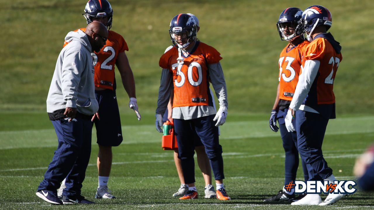 Running Backs Coach Curtis Modkins with fullback Andy Janovich and running backs Phillip Lindsay, Jeremy McNichols and Devontae Booker during practice on October 26, 2018 at UCHealth Training Center.