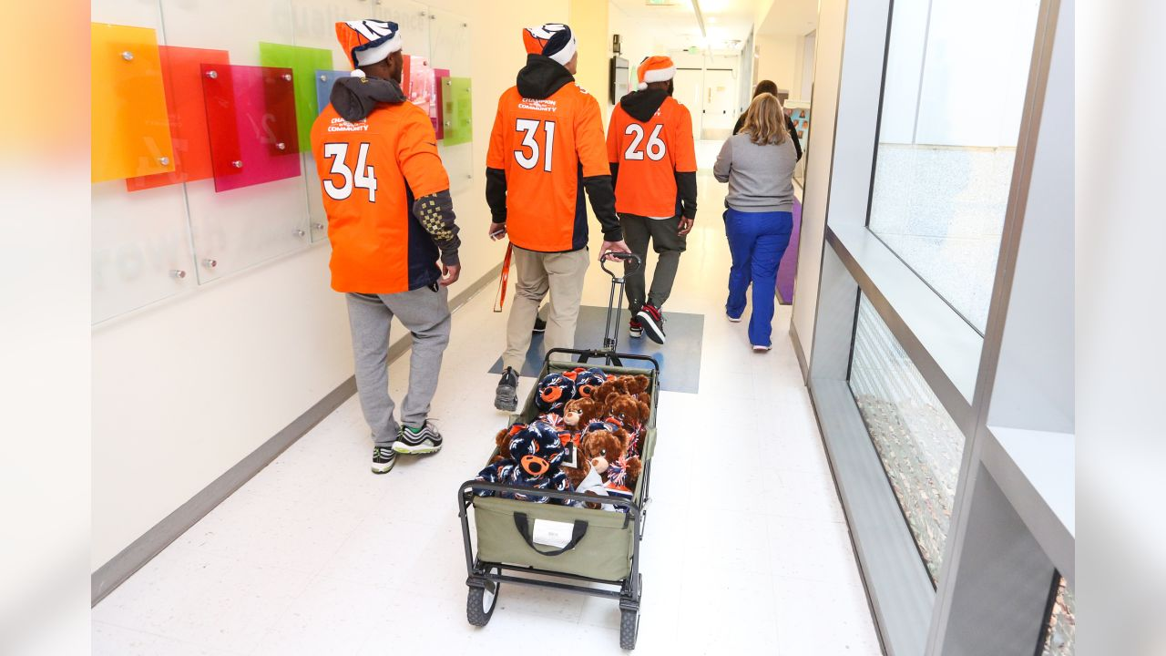 (From left) Will Parks, Justin Simmons and Darian Stewart during a Build-A-Bear distribution at Children's Hospital Colorado in Aurora on December 10, 2018.