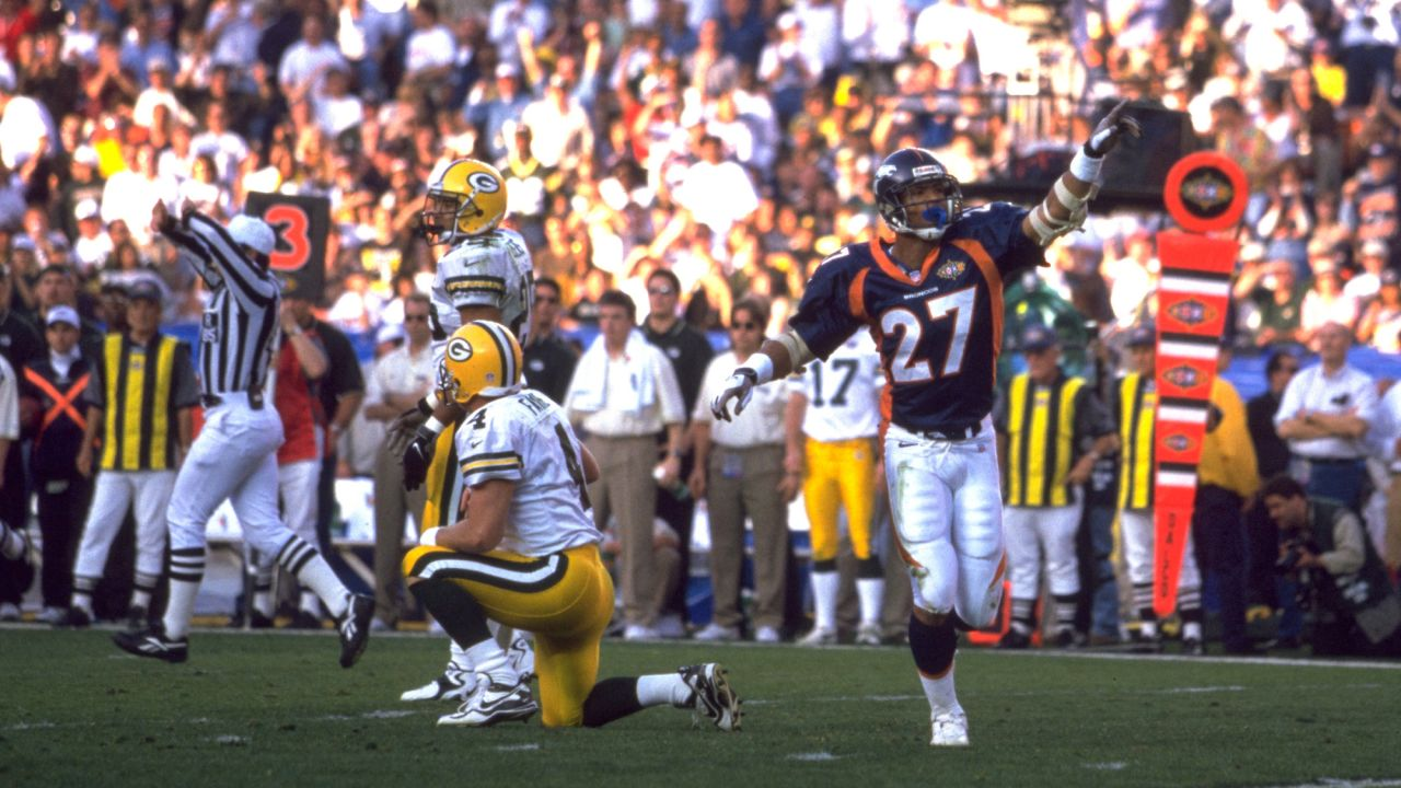 San Diego:  Steve Atwater blitzes from the blindside and sacks Brett Favre on the Green Bay 33 during Green Bays first possession of the second quarter.  The fumble was recovered by Neil Smith and led to a 51 yard field goal by Jason Elam against the Green Bay Packers at Qualcomm Stadium in San Diego, CA on January 25, 1998.