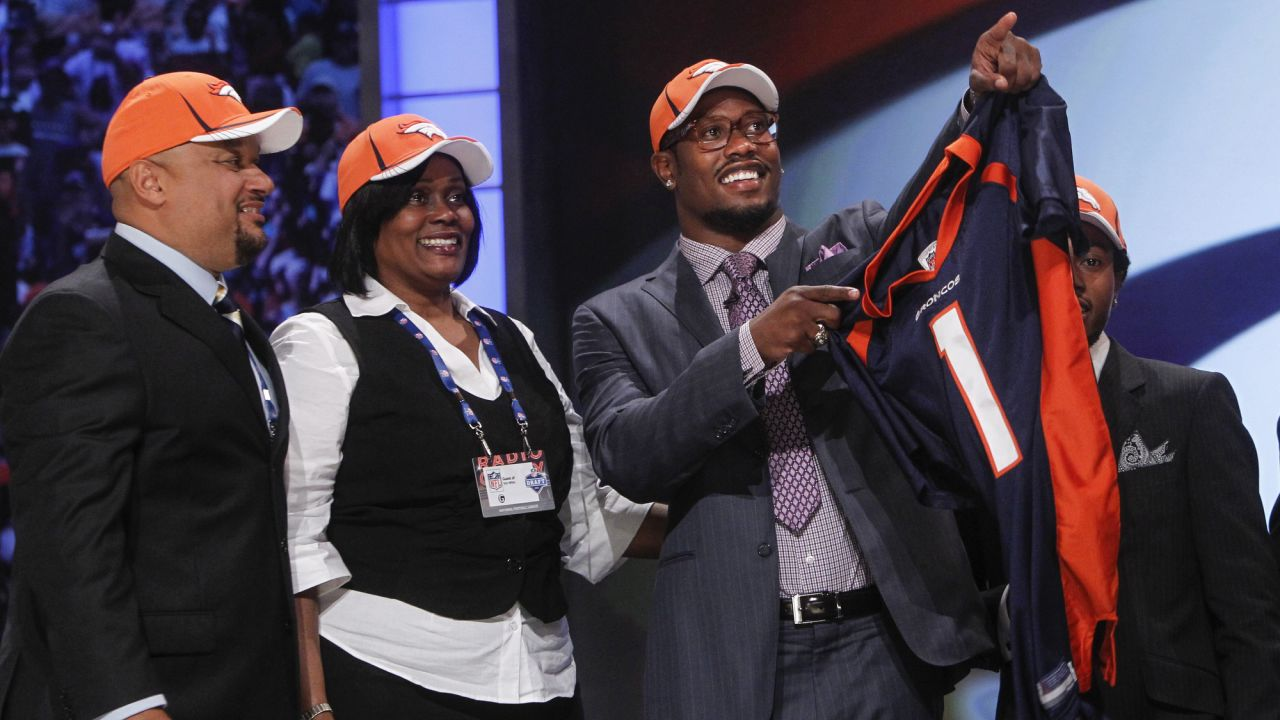 April 28, 2011: Von Miller, right, gestures alongside his family after he was selected as the second-overall pick by the Denver Broncos in the first round of the NFL Draft at Radio City Music Hall in New York City. (AP Photo/Jason DeCrow)