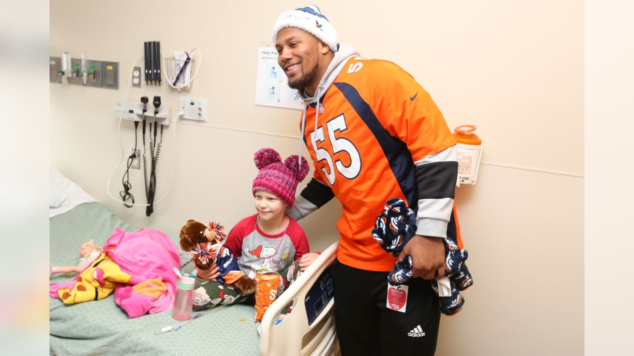 Bradley Chubb and a patient pose during a Build-A-Bear distribution at Children's Hospital Colorado in Aurora on December 17, 2018.