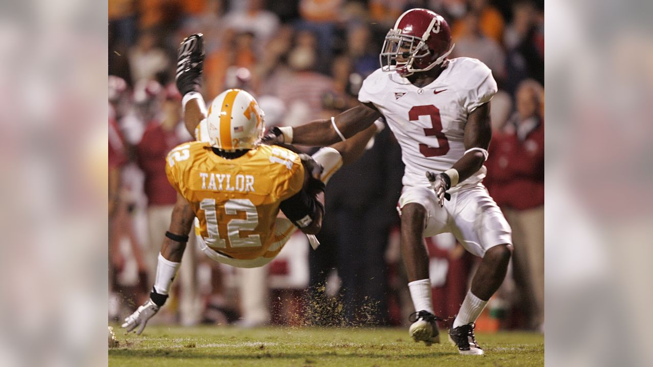 Tennessee's Lucas Taylor (12) is tackled as he's defended by Kareem Jackson (3) during the first half of a NCAA college football game against Alabama on Oct. 25, 2008 in Knoxville, Tenn. Alabama won 29-9.(AP Photo/Wade Payne)