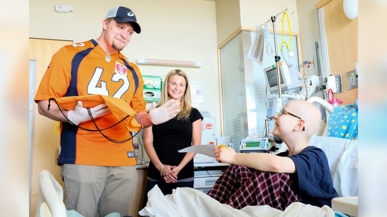 March 23 Long snapper Casey Kreiter and his wife visit a child at Children's Hospital Colorado, offering comfort and Broncos gear.