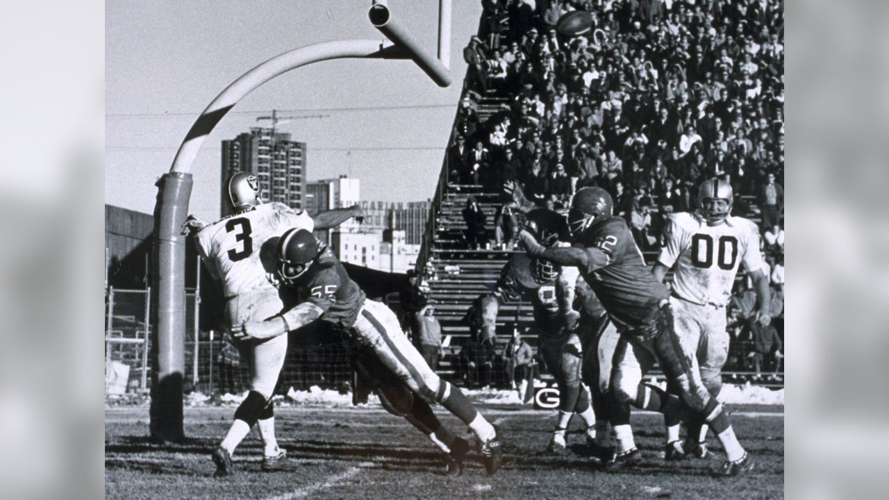 Defensive end Pete Duranko hits Raiders quarterback Daryle Lamonica as defensive tackle Jerry Inman jumps to block his pass during a November 5, 1967 loss (17-21) to Oakland at Bears Stadium.