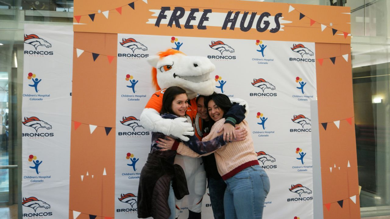 Miles the mascot gives out free hugs at a booth set up at Children's Hospital Colorado during a visit for Random Acts of Kindness Week on February 19, 2019.
