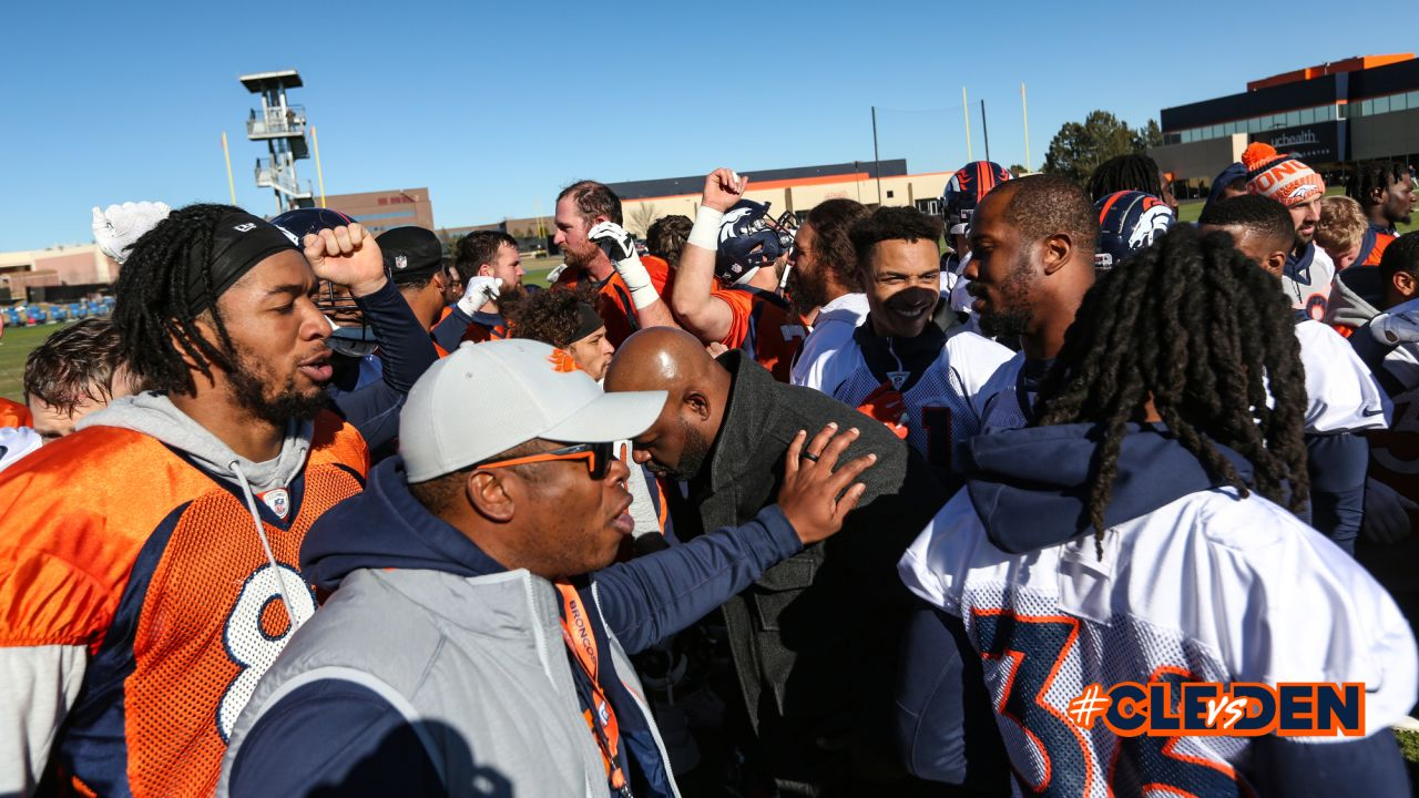 The team breaks down the huddle with former Broncos linebacker Al Wilson at the center after practice on December 13, 2018 at UCHealth Training Center.