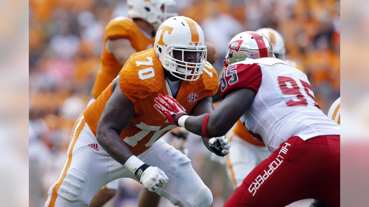 Tennessee offensive lineman Ja'Wuan James (70) blocks Western Kentucky defensive lineman Raphael Cox (95) during an NCAA college football game on Saturday, Sept. 7, 2013 in Knoxville, Tenn. (AP Photo/Wade Payne)