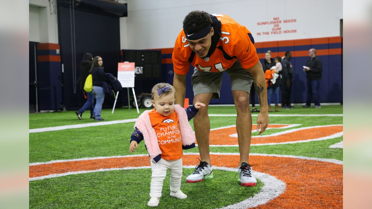 Justin Simmons and his daughter, Laney, during a PLAY 60 All-Ability Clinic with the National Sports Center for the Disabled for 200 athletes at UCHealth Training Center at April 30, 2019.