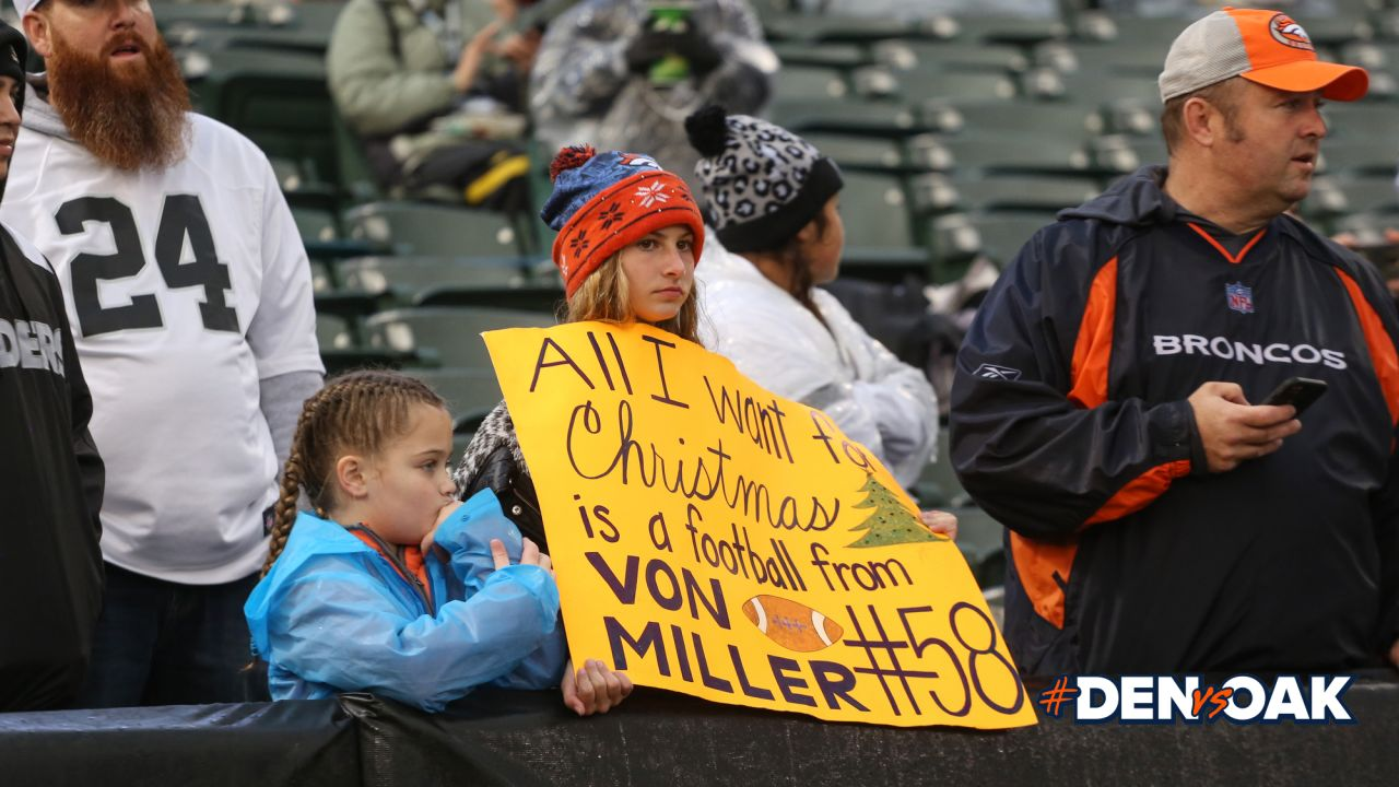 A Broncos fan holds a sign pregame before the Broncos' Week 16 game against the Oakland Raiders on December 24, 2018.