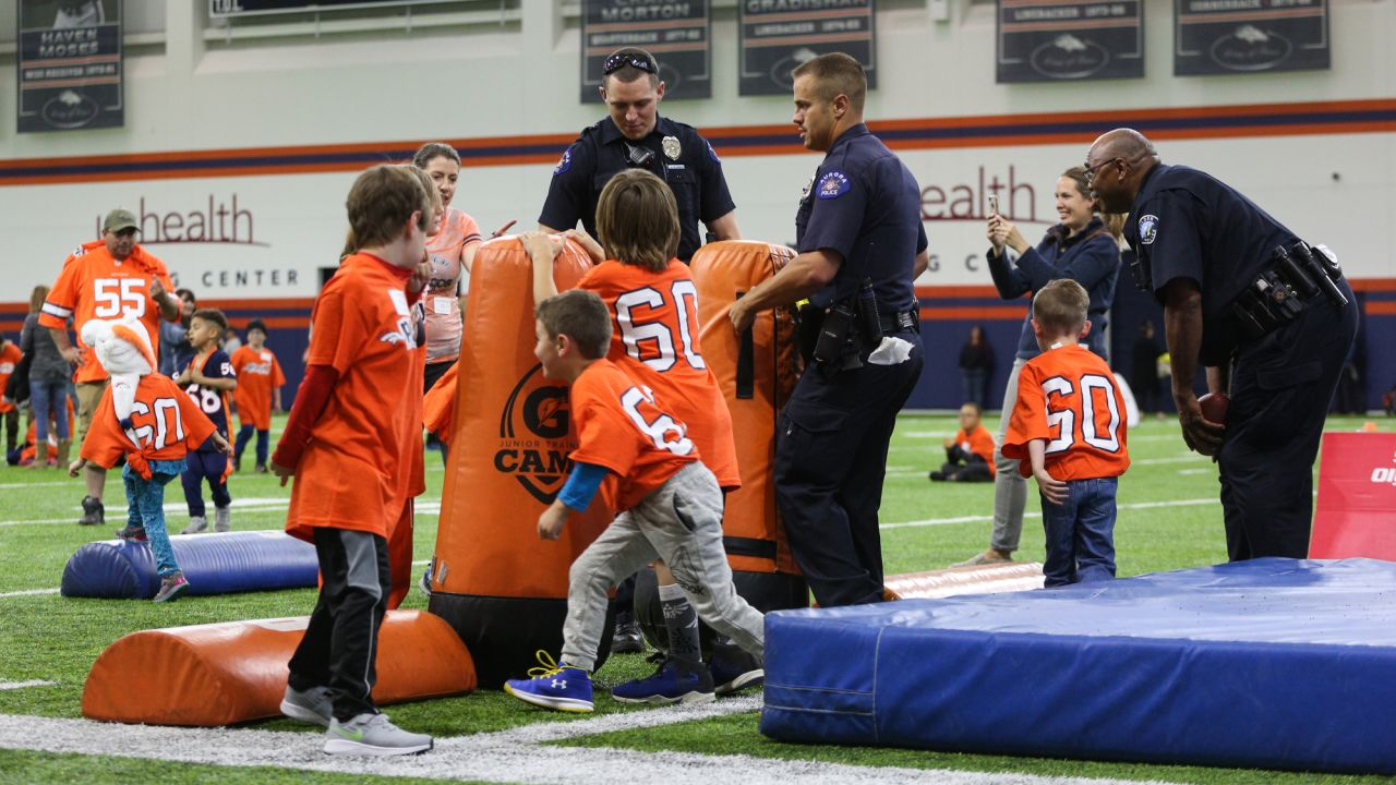 Members of law enforcement chat with kids during a PLAY 60 All-Ability Clinic with Special Olympics Colorado for 125 athletes at UCHealth Training Center at May 7, 2019.