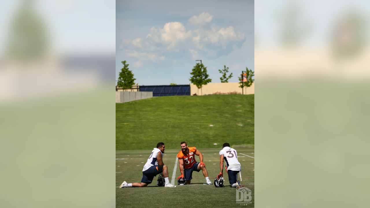 nose tackle Kyle Peko (90), fullback Andy Janovich (32) and safety Justin Simmons (31) before the ninth day of OTAs on June 6, 2018 at UCHealth Training Center.