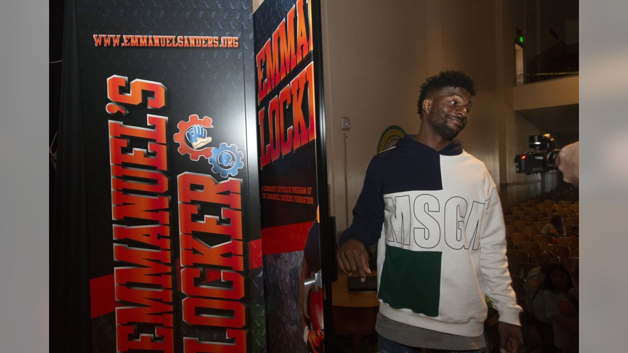 "Emmanuel Sanders provided sports equipment for students at Kepner Beacon Middle School on Wednesday through his ""Emmanuel's Locker"" program.  Sanders announced the donation in an assembly that featured a question-and-answer session with students."