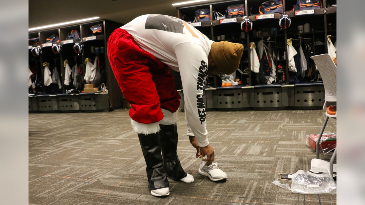 Von Miller puts on a Santa Claus outfit before the Broncos' Boys & Girls Club holiday party for about 200 children from the Boys & Girls Clubs of Metro Denver at UCHealth Training Center on December 17, 2018.