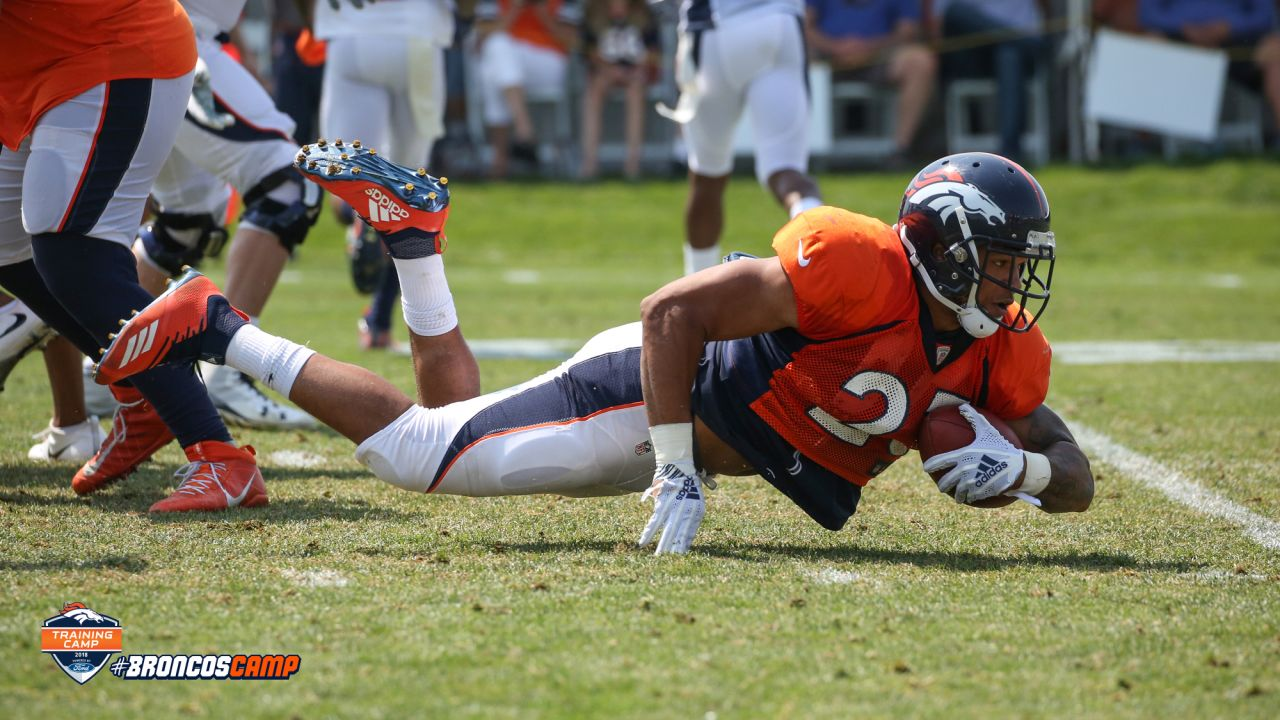 Running back Devontae Booker (23) stretches out for extra yardage during the ninth day of training camp on August 7, 2018, at UCHealth Training Center.